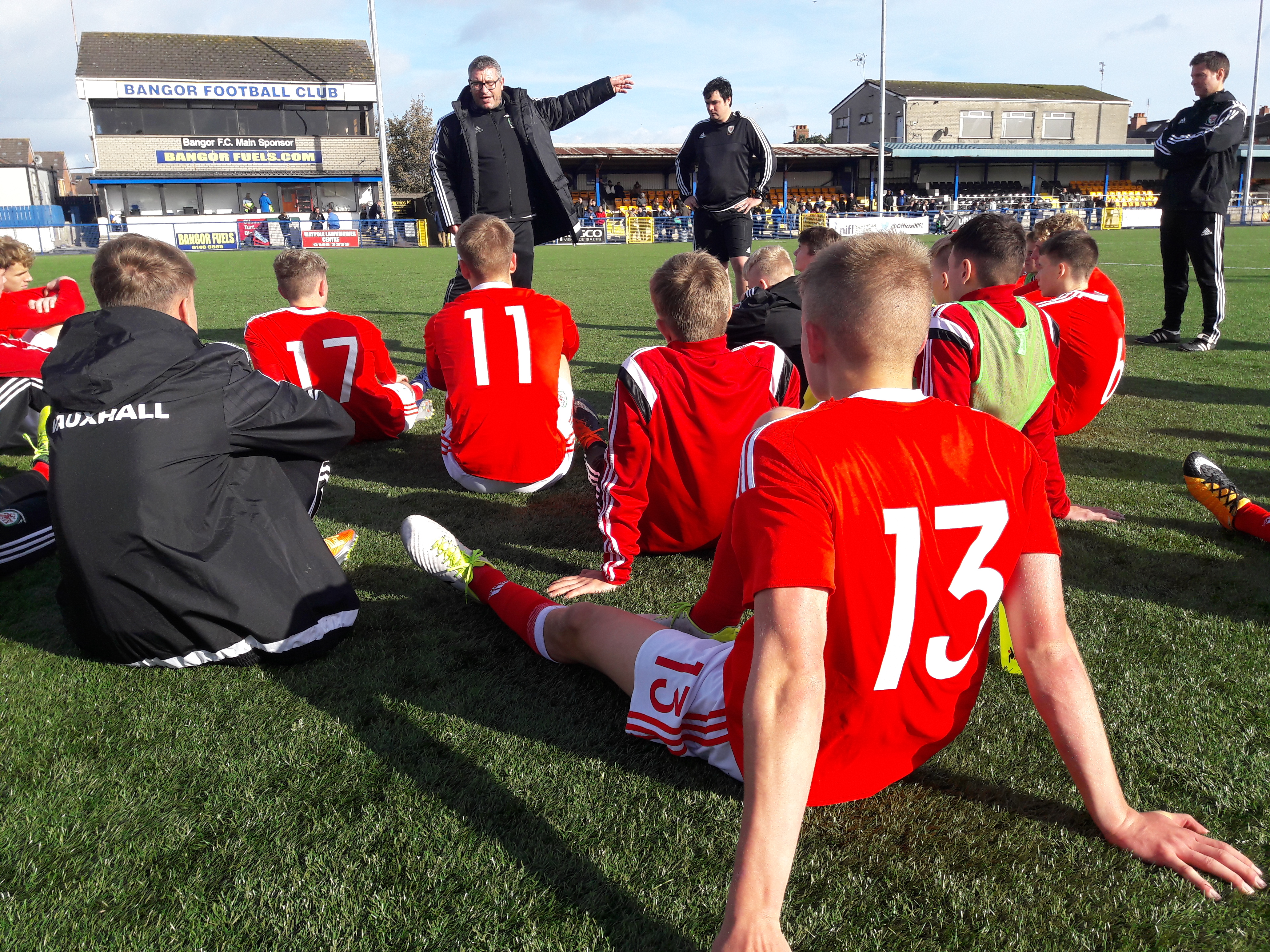 Osian Roberts gives the Wales Victory Shield squad a team-talk